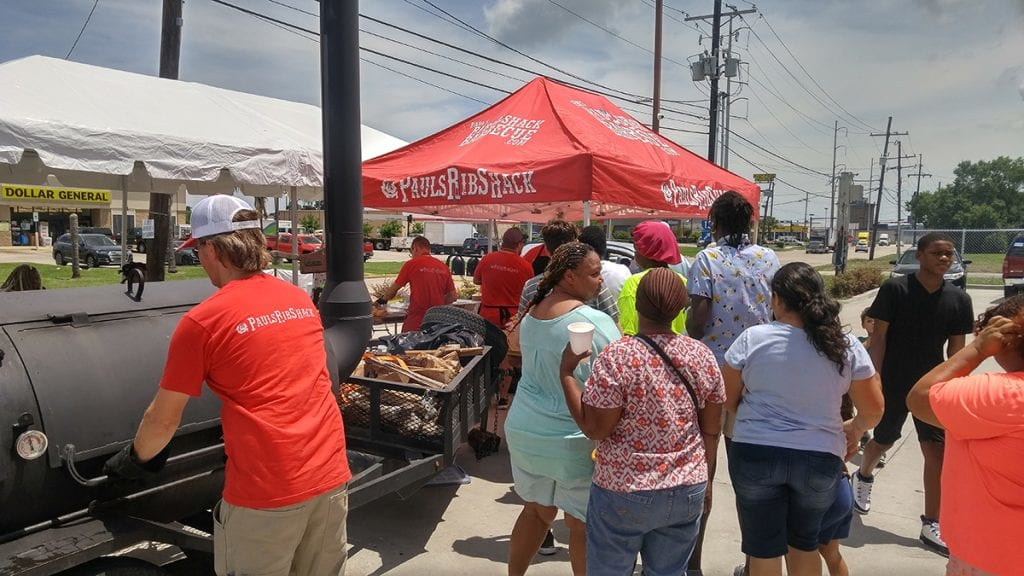 Paul Pettefer Bishop of BBQ serving food at free laundry day in New Orleans